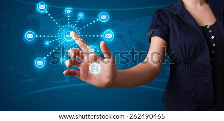 Young woman pressing virtual messaging type of icons - stock photo