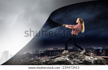Young woman pulling page to change scene