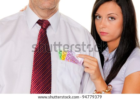 young woman pulls a man out of his pocket money. euro