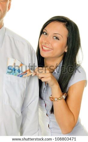 young woman pulls a man out of his pocket swiss francs - stock photo