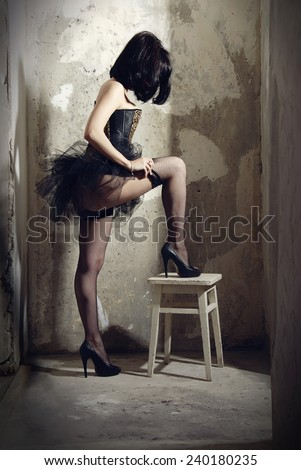 Young woman pulls stockings - stock photo