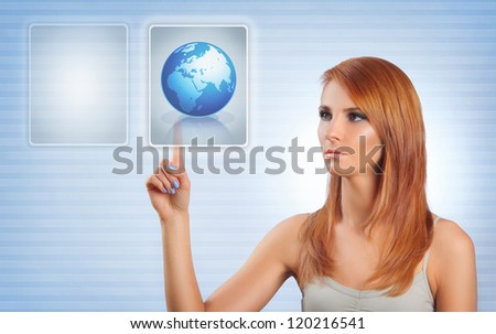 young woman pushing button on touch screen - stock photo