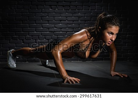 Young woman pushing up on floor - stock photo