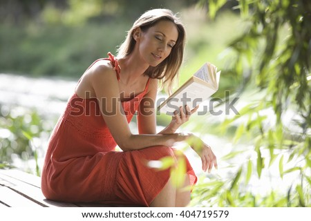 Young woman reading a book - stock photo
