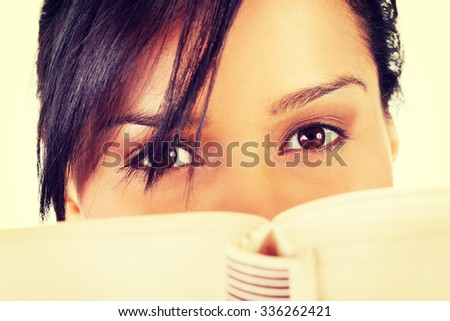 Young woman reading an old book. - stock photo