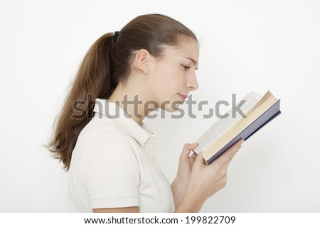 Young woman, reading book