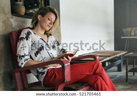 Young Woman Reading Book Concept