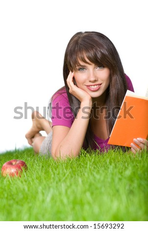 young woman reading book in the grass. white background - stock photo