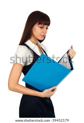 young woman reading documents on a blue binder