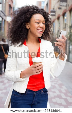 young woman reading her text messages. - stock photo