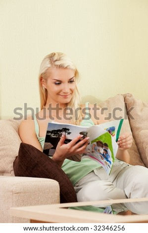 Young woman reading magazine - stock photo