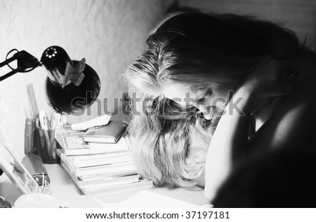 Young woman reading near lamp - stock photo