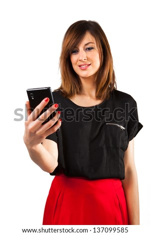 Young woman reading on mobile phone. White background.