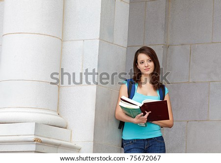 young woman reading on school campus - stock photo
