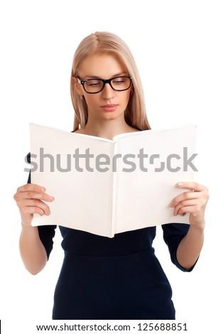 Young woman reading womens magazine - stock photo