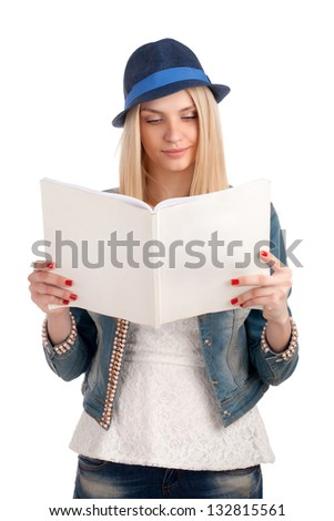 Young woman reading womens magazine - stock photo