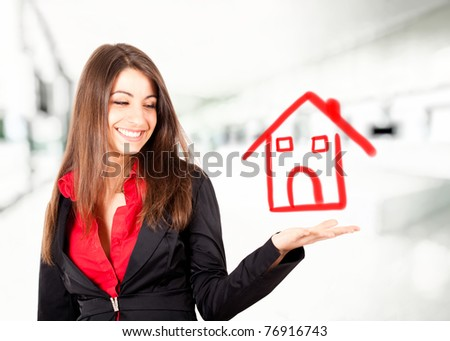 Young woman real estate concept - stock photo