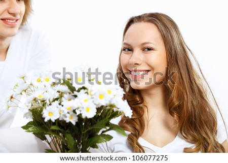 Young woman receiving a gift from her boyfriend - stock photo