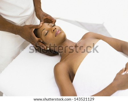 Young woman receiving a massage - stock photo