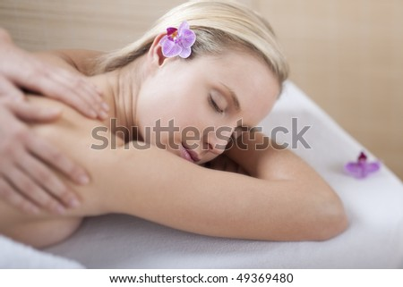 Young woman receiving back massage, selective focus