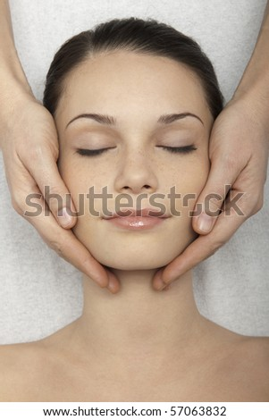 Young woman receiving head massage