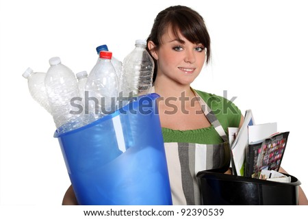 Young woman recycling - stock photo