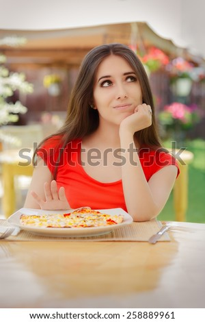 Young Woman Refusing  To Eat a Pizza - Beautiful girl saying no to fast food   - stock photo