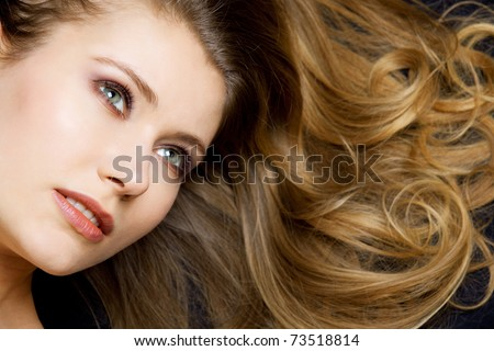 young woman relaxing and showing her beautiful hair - stock photo