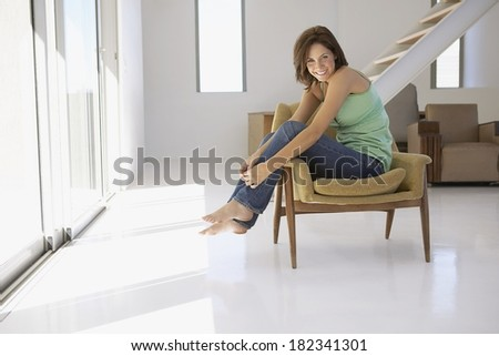 Young woman relaxing at home - stock photo