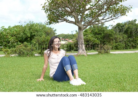 Young woman relaxing at the park