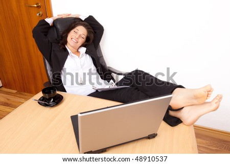 Young woman relaxing at work - stock photo