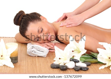 young woman relaxing beeing massaged in spa saloon