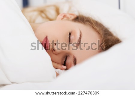 Young woman relaxing in bed