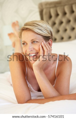 Young Woman Relaxing In Bedroom - stock photo