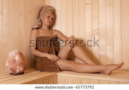 young woman relaxing in Finnish sauna - stock photo