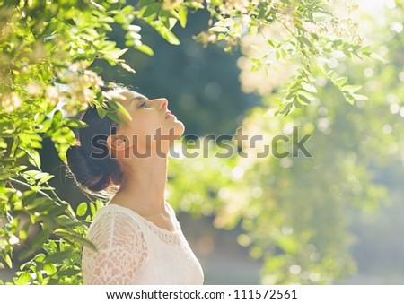 Young woman relaxing in forest - stock photo
