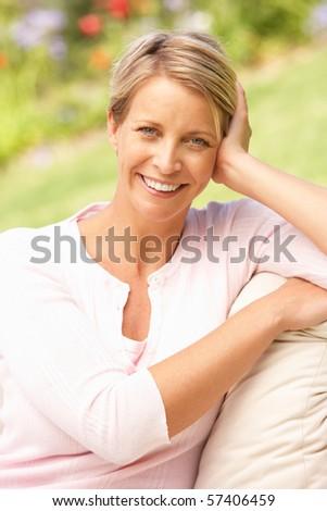 Young Woman Relaxing In Garden - stock photo