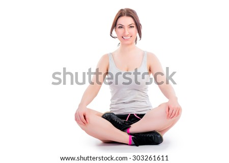 Young woman relaxing in lotus position