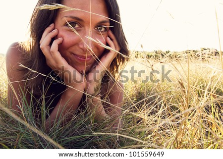 young woman relaxing in nature - stock photo