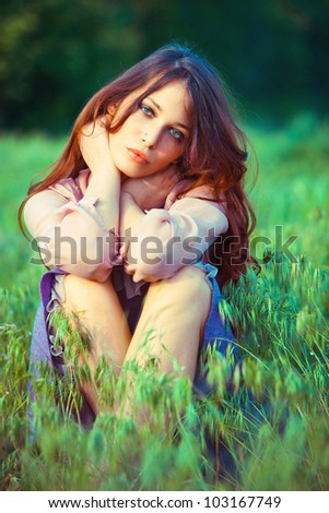 young  woman relaxing in nature summer day - stock photo