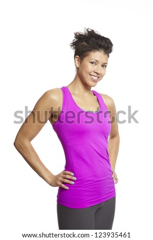 Young woman relaxing in sports outfit smiling on white background - stock photo