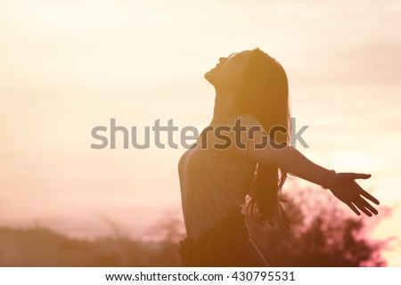 Young woman relaxing in summer sunset sky outdoor. People freedom style. - stock photo