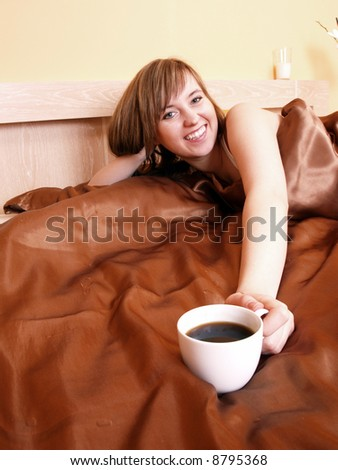Young woman relaxing in the bedroom