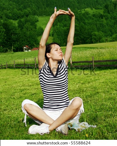 Young woman relaxing in the nature - stock photo