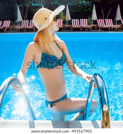 Young woman relaxing in the pool