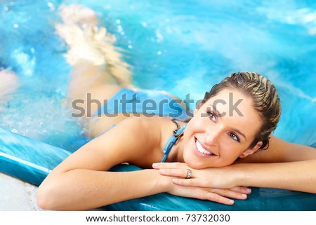 Young woman relaxing in the water. Summer. - stock photo