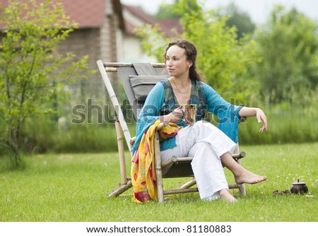 Young woman relaxing on a deck chair