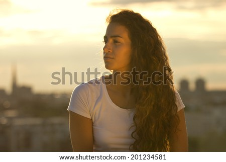 Young woman relaxing on a park - stock photo