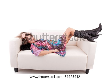 Young woman relaxing on couch, isolated on white - stock photo