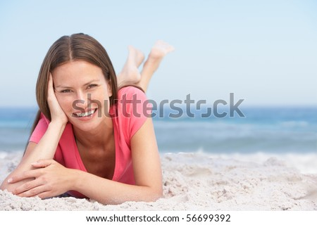 Young Woman Relaxing On Sandy Beach - stock photo
